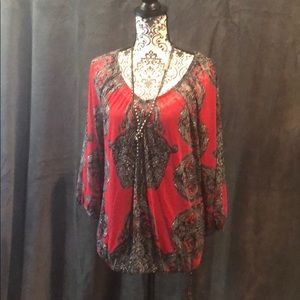 Sheer red blouse with black camisole